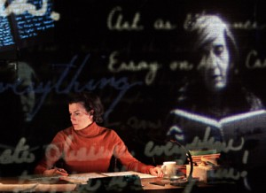 """Adapter/Performer Moe Angelos as Susan Sontag in """"Sontag: Reborn"""" by The Builders Association. Photo by James Gibbs."""