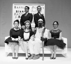 "Wesleyan University's Theater Department presents ""The Bald Soprano."" Sitting (left to right): Sara Fayngolz '17, Natalie May '18, Peter McCook '16, Grace Nix '15. Standing (left to right): Edward Archibald '17, Albert Tholen '15. Photo by John Carr."
